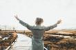 Leinwandbild Motiv Glückliche Seniorin in der Natur