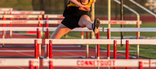 One Athlete Running In The Hurdles