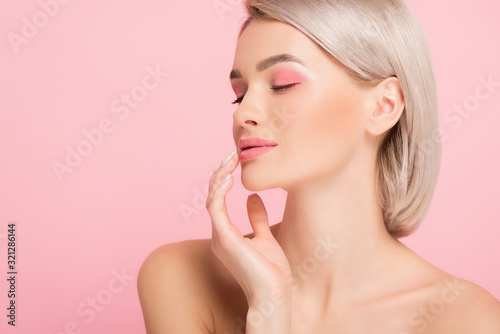 Vászonkép attractive girl with pink makeup, isolated on pink