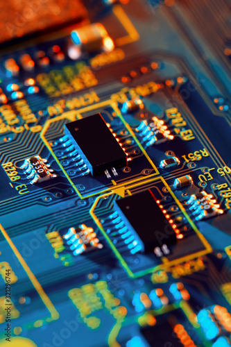 Electronic circuit board with electronic components such as chips close up. The concept of the electronic computer hardware technology. Fototapete