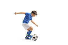 Boy In A Blue Jersey Playing F...