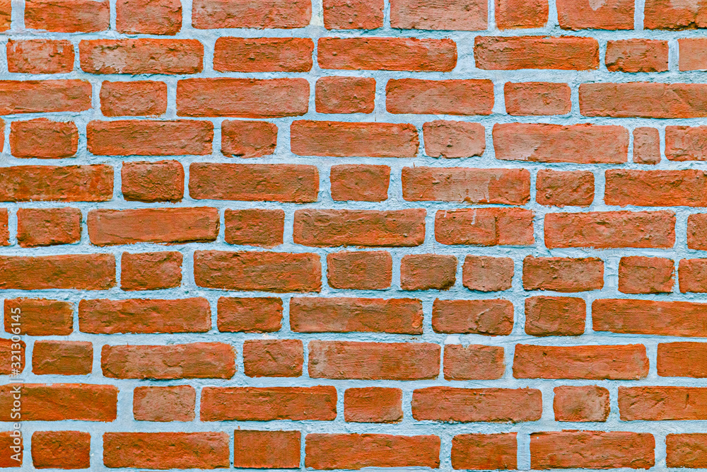 Old red brick wall vintage texture for wallpaper design. Grunge stonewall background for text or image. brick wall of red color, wide panorama of masonry.