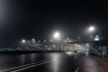 Foggy Misty Night Road And Ove...