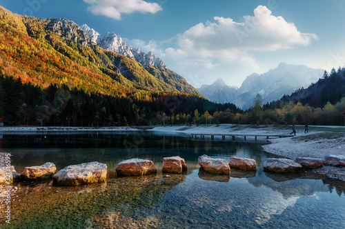 Wall mural - Amazing nature Landscape in Julian Alps during sunset. Lake Jasna near Kranjska Gora, Slovenia. Crystal clear alpine with perfect sky and mountain peaks in background. Triglav national park