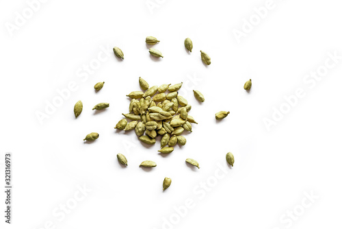 Fototapeta Top view of a pile of organic dry cardamom seeds isolated on a white background obraz