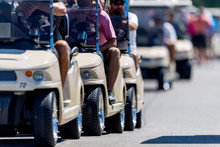 Row Of Golf Carts Driving On A...