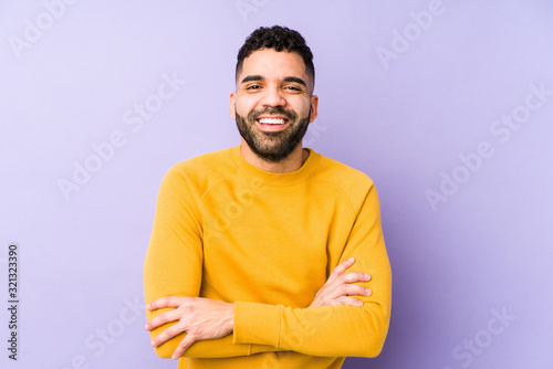 Fotografia Young mixed race arabic man isolated laughing and having fun.