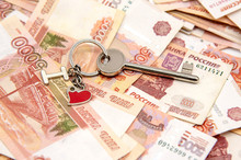 A Metal Key On Five-thousand-ruble Notes. Concept Photo As A Symbol Of Improving Living Conditions, Buying Or Renting A Home.
