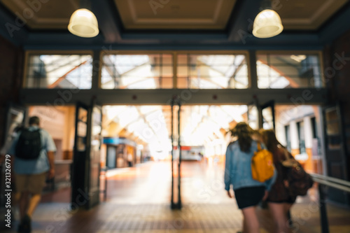 Blur image of People passing through Wellington Railway Station, New Zealand