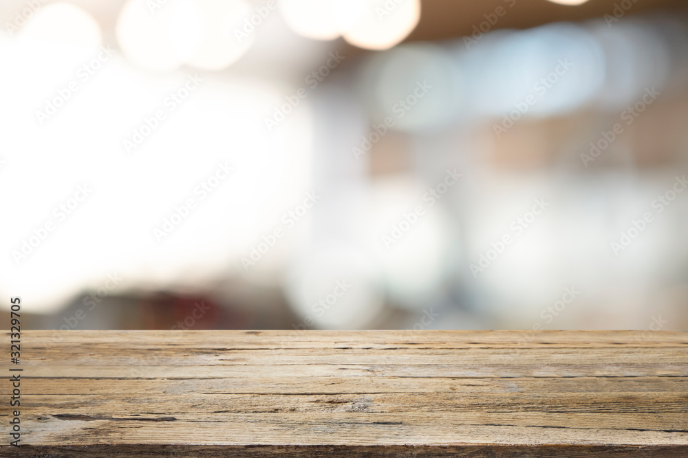 Fototapeta Empty wooden table for present product on coffee shop blur background.
