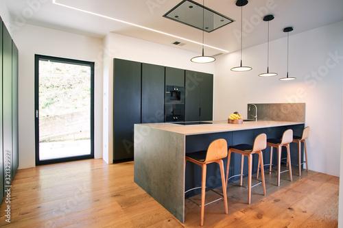 Fototapeta Modern kitchen with counter and chairs obraz na płótnie