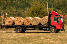 Truck Loaded With Round Hay Ba...