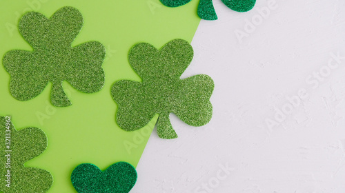 Green shamrock clover for St. Patrick's Day irish celebration, copy space for holiday background.
