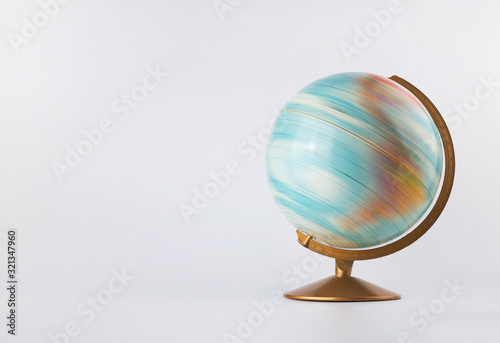 Fotografia Spinning globe model in motion isolated on white background