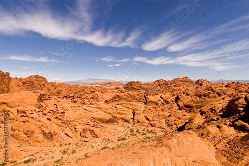Scenic view of orange desert rocks against a blue sky in the southwest USA