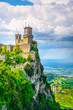 canvas print picture - San Marino, medieval tower on a rocky cliff and panoramic view of Romagna
