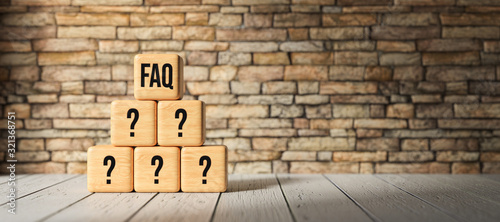 cubes with the abbreviation FAQ in front of a brick wall on wooden floor Wallpaper Mural