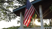 American Flag Waving With Sun ...