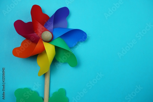 colorful pinwheel with space copy isolated on blue background Tablou Canvas
