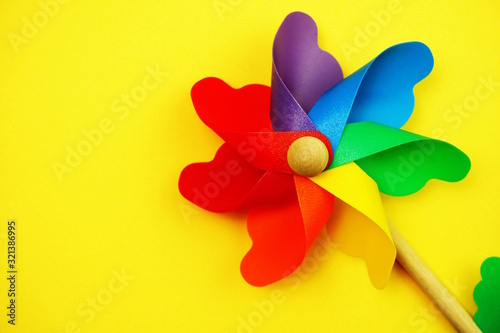 colorful pinwheel with space copy isolated on yellow background Tablou Canvas