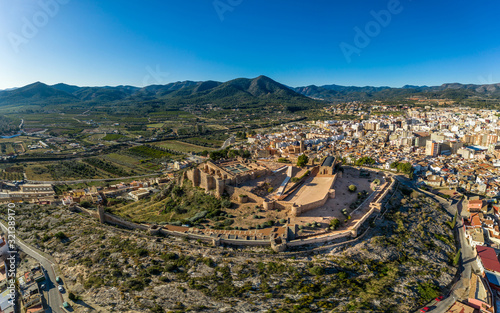 Платно Aerial view of medieval Onda partially restored medieval castle ruin in Spain wi