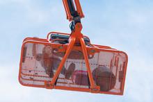 Worker On A Telescopic Boom Lift Platform
