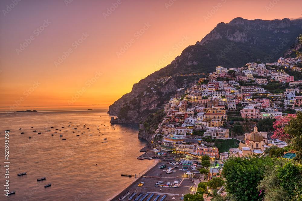 Fototapeta The famous village of Positano on the italian Amalfi coast after sunset