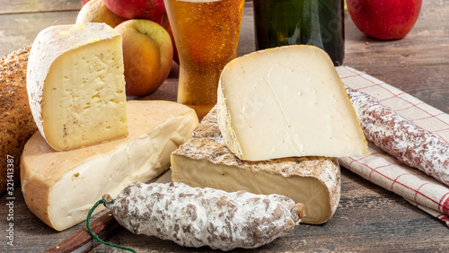 Leinwand Poster cheeses and Tomme de Savoie with beer, French cheese Savoy, french Alps France