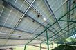 Leinwanddruck Bild Green metallic carcass maintaining solar batteries. smart exterior, using renewable sun energy. Ecological friendly, nature saving, economical. Innovative high-tech technologies. Renewable resources.