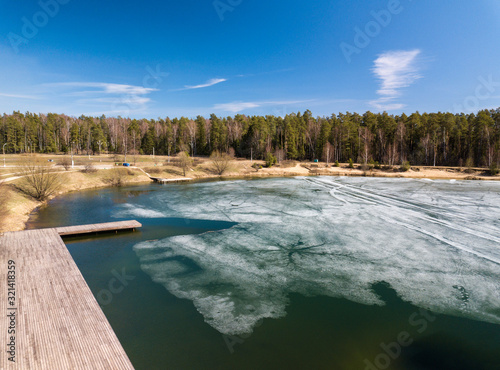 Last melting ice on the pond in the springtime Canvas Print