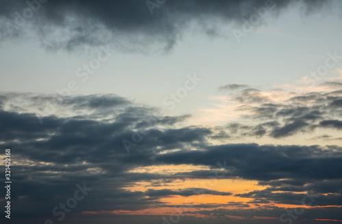 Fototapeta Beautiful sunset in dark orange colors in winter by the sea obraz na płótnie