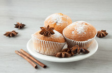 Tasty Muffins On A Plate Ready To Eat. Cinnamon Sticks And Star Anise.