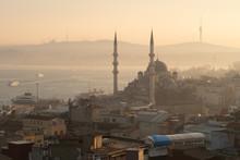 Istanbul, Turkey - Jan 15, 2020: New Mosque (Yeni Cami) With Bosphorus Strait Behind, Istanbul, Turkey, Europe