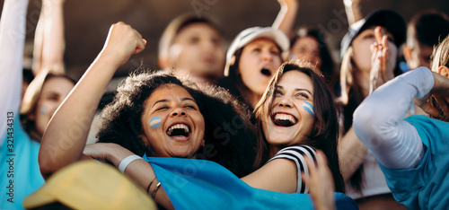 Fototapeta Excited crowd of sports fans celebrating their team's victory obraz