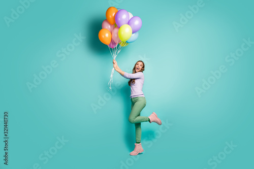 Photo Full length profile photo of pretty funky lady hold many colorful air balloons g