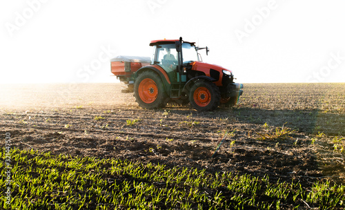 Obraz Tractor spreading artificial fertilizers - fototapety do salonu