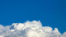 White Cumulus Clouds Against T...