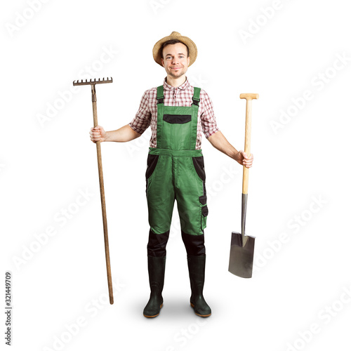 Fotografie, Obraz Happy gardener holding a rake and a spade - white background