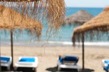 Straw Beach Umbrellas And Sunb...