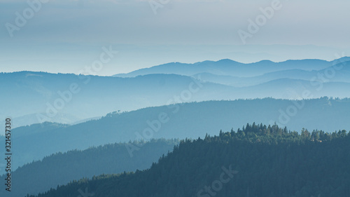 View from the Feldberg over hazy hills. Fotobehang