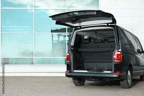 Modern car with open empty trunk outdoors