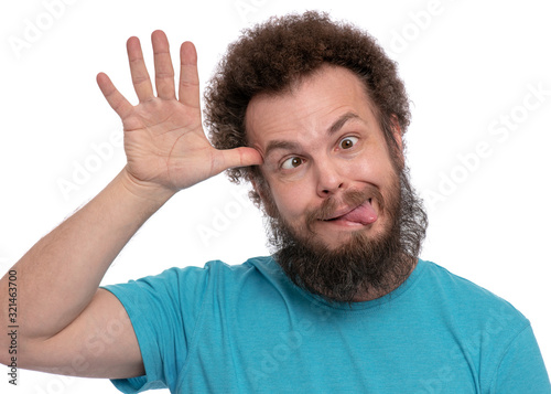 Photo Emotional portrait of bearded man with Curly Hair, shows tongue, isolated on white background