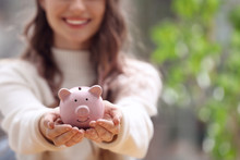Woman Holding Piggy Bank Again...