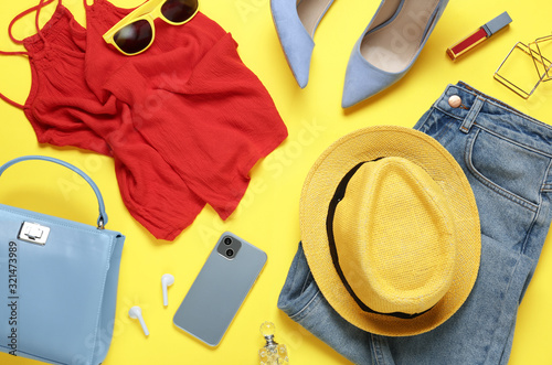 Flat lay composition with smartphone and stylish clothes on yellow background Canvas Print