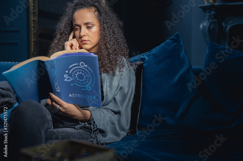 Young woman learning the basics of astrology Canvas Print