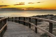 Wooden walkway to the beach at sunrise in Alicante, Spain