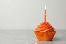 Delicious Birthday Cupcake With Cream And Burning Candle On Marble Table. Space For Text