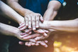People hands assemble as a connection meeting teamwork concept. Group of people assembly hands as business or work achievement. Man and women touch each other hands outdoor. Teamwork conceptual.