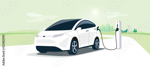 Fototapeta Electric car on charging station with green city street skyline. Battery EV vehicle plugged and getting electricity from renewable power generations solar panel, wind turbine. Vehicle being charged. obraz