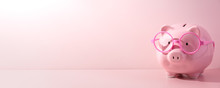 Pink Piggy Bank On A Pink Background